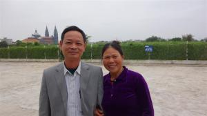 Chief of the farmers cooperative and his wife in front of their field