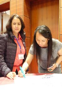 Yamuna Ghale signing her action plan